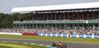 Lando Norris, McLaren MCL35M, leads Daniel Ricciardo, Silverstone